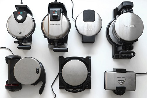 Different Types Of Waffle Makers On White Surface